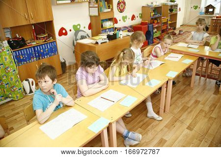 Moscow, Russia-april 17, 2014: Children Play With Toys And Engage  The Tutor In A Kindergarten