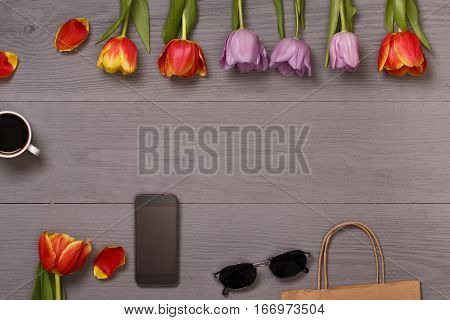 Lilac and red tulips and coffee in the lilac wooden table. Banner template layout mockup for Woman Day, Valentines Day and Teacher's Day. Photo for posts, blogs, advertising and news.