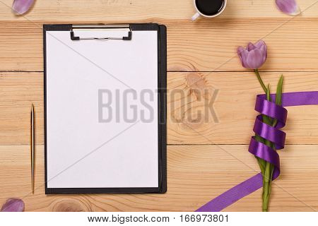 Lilac tulip and coffee in the wooden table. Banner template layout mockup for Woman Day, Valentines Day and Teacher's Day. Photo for posts, blogs, advertising and news. Banner space for text