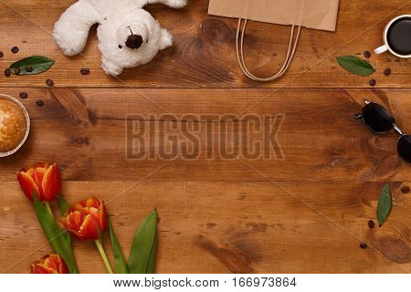 Red tulips  and teddy bear in the  wooden table. Banner template layout mockup for Woman Day, Valentines Day and Teacher's Day. Photo for posts, blogs, advertising and news.