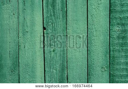 Old wooden green painted fence beautiful background for your design