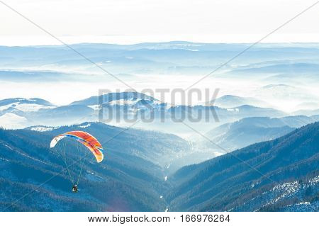 Paragliders Launched Into Air From The Very Top Of A Snowy Slope Of A Mountain