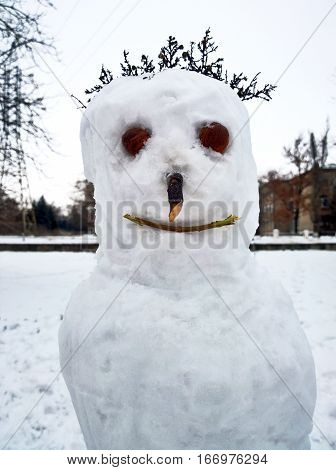 Snowman with hair close-up made by children in the city of Krivoy Rog in Ukraine