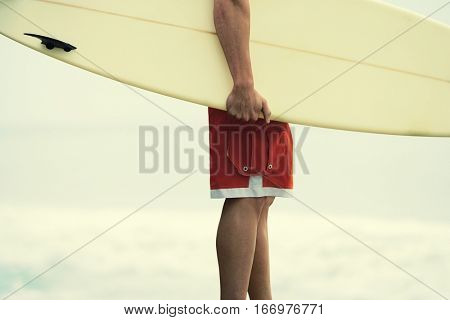 Surfer dude holding a surfboard