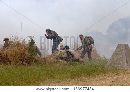 WESTERNHANGER, UK - JULY 24: German infantry surrender to RM Commandos as part of the battle re-enactment for the public to watch during the War & Peace revival show on July 24, 2015 in Westernhanger