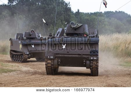 WESTERNHANGER, UK - JULY 24: Two M113 APC's head around the arena at the War & Peace revival show as part of the entertainment for the watching public on July 24, 2015 in Westernhanger