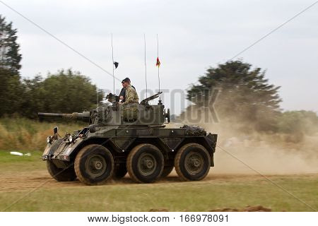WESTERNHANGER, UK - JULY 24: An ex British army Saladin armoured car races around the arena at the War & Peace revival show as entertainment for the watching public on July 24, 2015 in Westernhanger