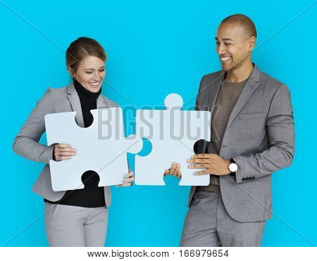 Business People Smiling Happiness Holding Jigsaw Puzzle Concept