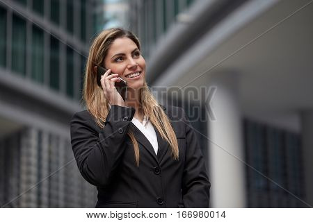 beautiful real estate agent talking to mobile