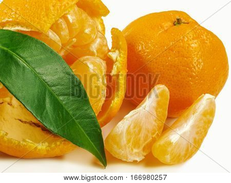 Mandarin, peeled mandarin with slices and green leaf
