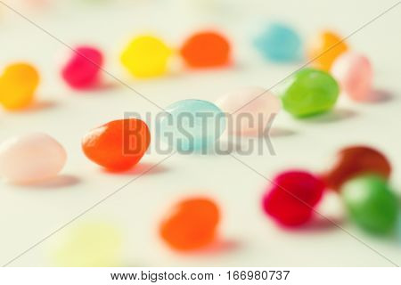 food, sweets, confectionery and unhealthy eating concept - close up of colorful jelly beans candies on table