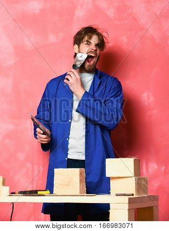 Shouting Man Holding Putty Knifes