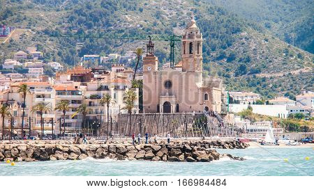 Long view of the Sitges church in a sunny day