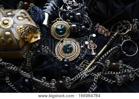 pirates treasure, vintage ornaments with precious stones and the old key to the treasure