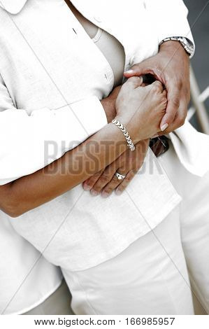 Midsection of an affectionate couple embracing on the yacht