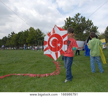ANKARA, TURKEY - APRIL 23, 2014 : Childs performed a kite show during the April 23 National Sovereignty and Children's Day at city park of Ankara.