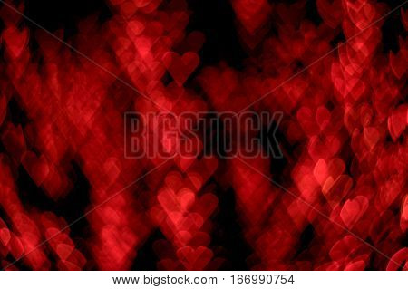 Valentine's Day Background bokeh effect red hearts dark black background