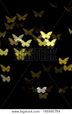 golden beautiful butterflies bokeh effect dark black background