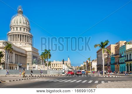 HAVANA,CUBA - JANUARY 24,2017 : Street scene in downtown Havana with a view of the Capitol building and old cars on the road