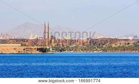 The minarets of the new mosque, towering above the port of Travco. South Sinai, Sharm El-Sheikh .