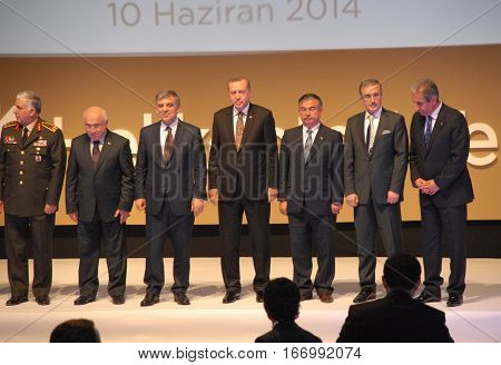 ANKARA, TURKEY - JUNE 10 2014 : Turkish Prime Minister Recep Tayyip Erdogan (Middle), Turkish President Abdullah Gul (3rd left) and VIP Persons on the stage of Turkish Land Forces Aviation Command