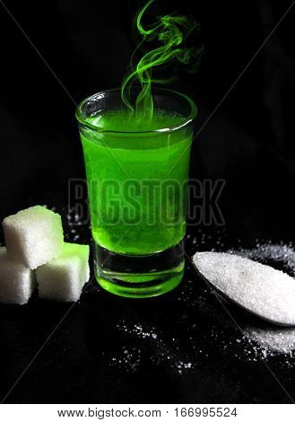 absinthe with sugar cubes and spoon flat lay composition poster