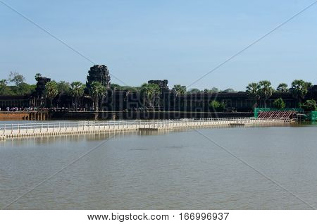 Siem Reap Cambodia - 23 January 2017: Construction of pontoon bridge over the western moat of Angkor Wat to facilitate the restoration of the main stone causeway over the next five years.