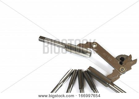 Hand tap (threading tool) with thread gauge isolated on white background.