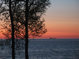 Sunrise With Freighter