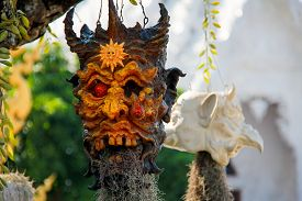 Terrifying Skull Flowerpot in Wat Rong Khun (or White Temple) Thailand from the Myth of Reincarnation in Buddhism with Roots germinate from the Mouth. Taken on April '11.