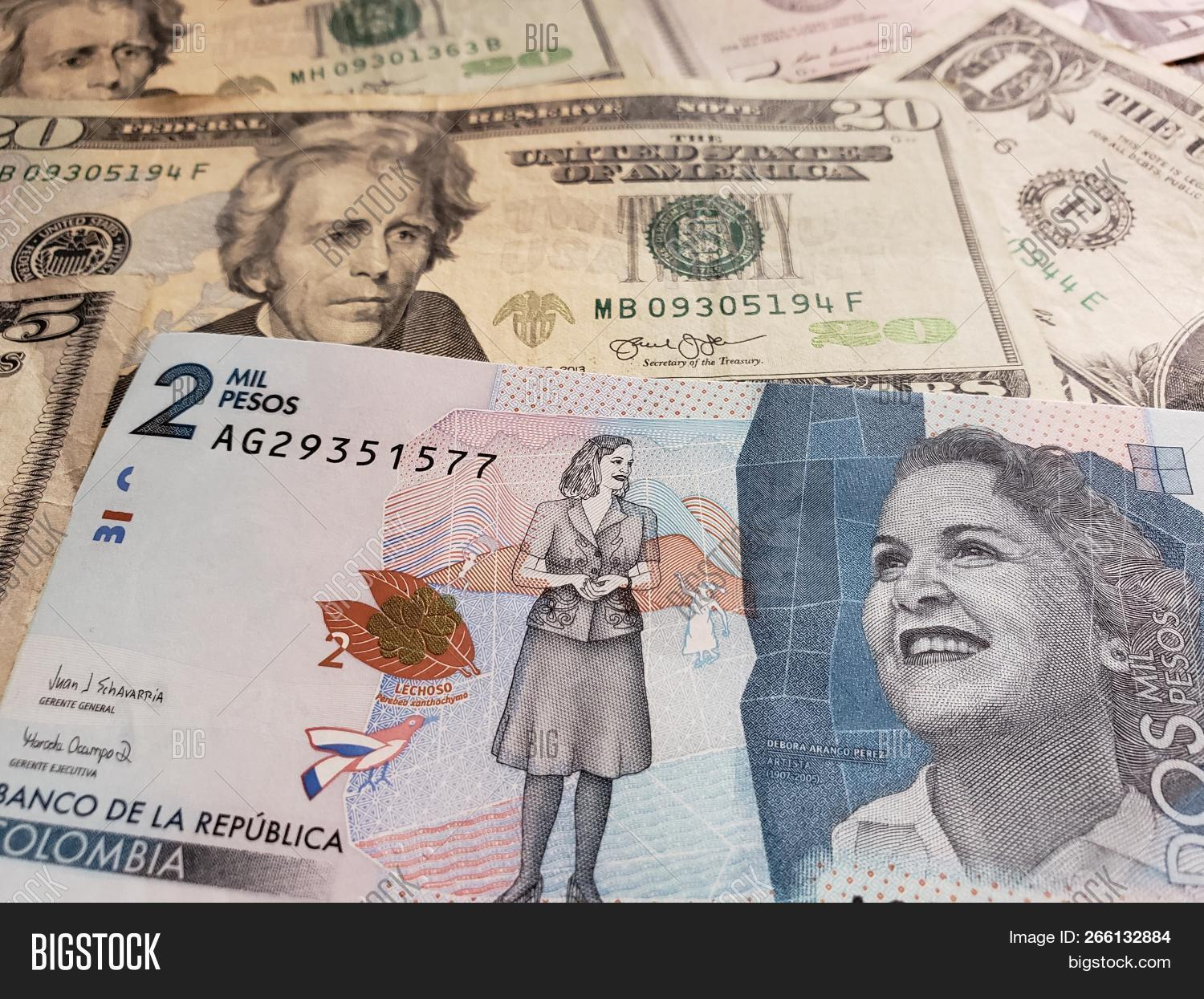Colombian Banknote Of 2000 Pesos And American Dollars Bills Background Texture