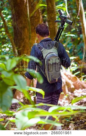 Man Is Carrying A Bird Watching Monocular On A Tripod In Rainforests Of Costa Rica (corcovado Nation