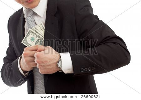 Man in a putting money in his pocket. Isolated over  white