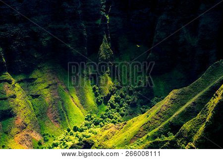 Landscape Detail Of Na Pali Coast Cliffs With Helicopter In Distance, Kauai, Hawaii