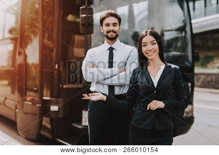 Young Smiling Business People Standing Next To Bus. Confident Attractive Man With Crossed Arms And B