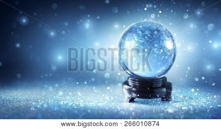 Snow Globe Sparkling In Shiny Blue Background
