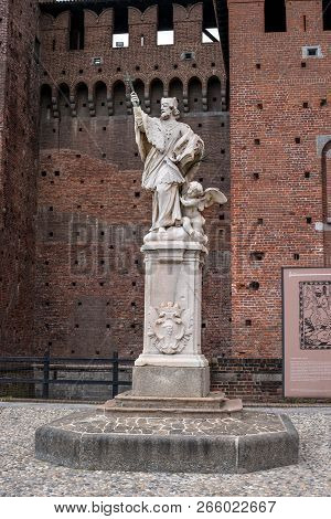Milan, Italy - 09 May 2018: Monument of the Czech saint John of Nepomuk in the Sforza Castle, The castle was built by Francesco Sforza. The monument is installed in the courtyard of the castle.