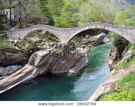 Ancient double arch stone bridge in Verzasca valley, Switzerland