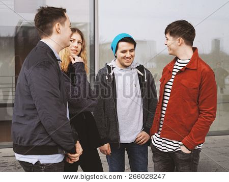Group Of Four Young Urban Teenage Friends Talking Laughing And Having Fun Together - Candid Real Peo