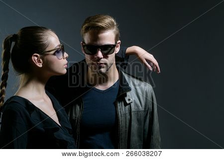 Real Love. Fashion Models In Trendy Sun Glasses. Couple In Love. Couple Of Man And Woman Wear Fashio