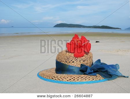 Straw hat on a desert beach of Langkawi, Malaysia poster