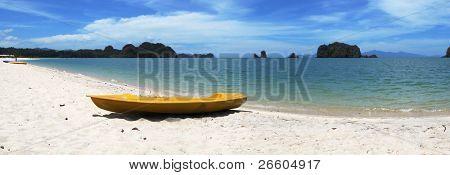 Yellow kayak on the famous Thanjung Rhu beach of Langkawi, Malaysia