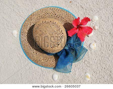 Sun hat on a sandy beach