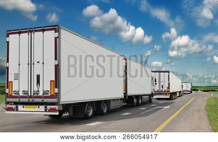 Container on the big highway. transport loads. Heavy traffic freight trailers on the highway. Cargo transportation