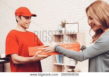 Pizza Delivery. Pizza Deliveryman. Girl With Pizza. Man With Box Is Funny Accessory. White Interior.