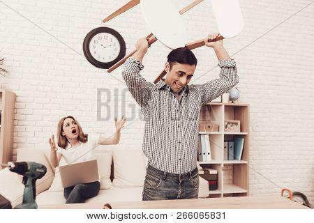 Assemble Furniture. Man Repairing Chair. Man Breaks Chair. Angry Furniture Assembler. Scared Woman I