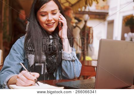 Young Attractive Business Woman With Long Hair Holds A Job Interview. Young Beautiful Woman Journali