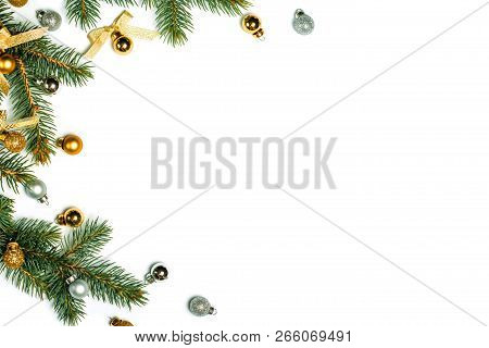 Christmas Background With Golden Decorations Put As Frame Isolated On White With Fir Branches. Brigh