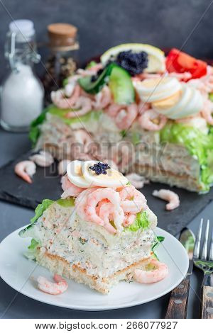 Piece Of Traditional Savory Swedish Sandwich Cake Smorgastorta With Bread, Shrimps, Eggs, Caviar, Di