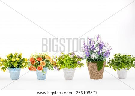 Rows Of Colorful Fake Flowers On White Background, Made From Cloth And Plastic For Decoration.
